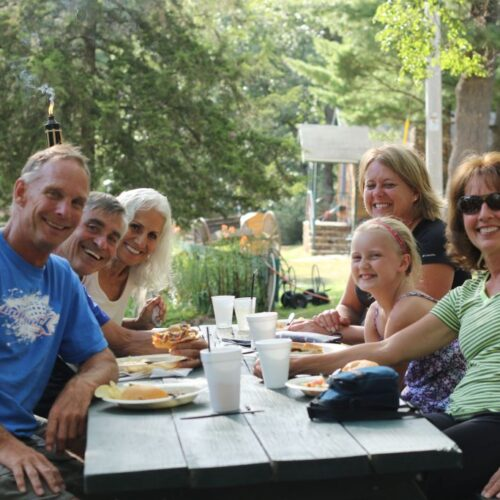 Family Eating Together At The Ranch