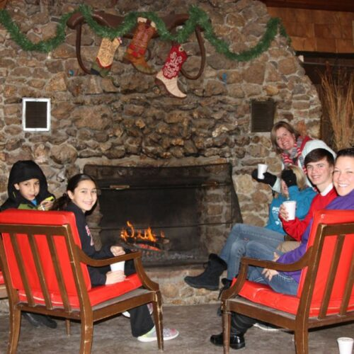 A Group In Enjoying The Fireplace