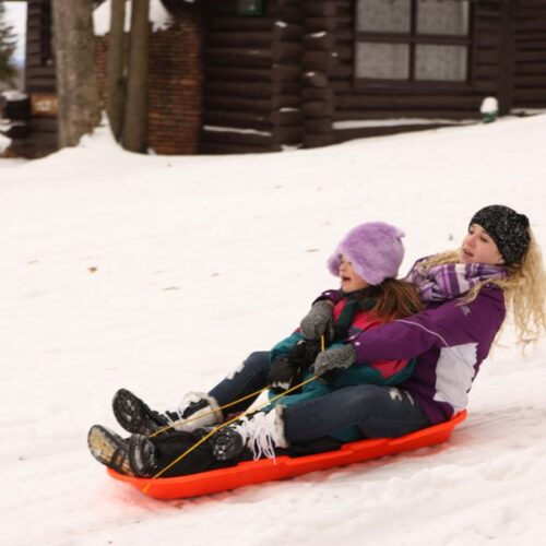 Two Women Sledding