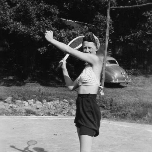 Vintage Photo Of A Woman Playing Tennis