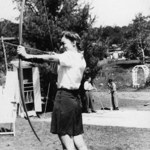 Vintage Photo Of A Woman Playing Archery