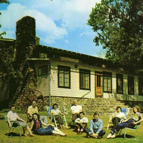 A Group Of People Sitting On Chairs Outside